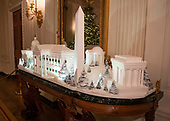 "The 2018 White House Christmas decorations, with the theme ""American Treasures"" which were personally selected by first lady Melania Trump, are previewed for the press in Washington, DC on Monday, November 26, 2018.  The traditional White House gingerbread house on display in the State Dining Room.  This year it shows the National Mall with the White House as it's centerpiece. <br /> Credit: Ron Sachs / CNP"