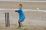 Matthew O'Shea is a picture of concentration the beach cricket festival in Bettystown. Photo: Andy Spearman.