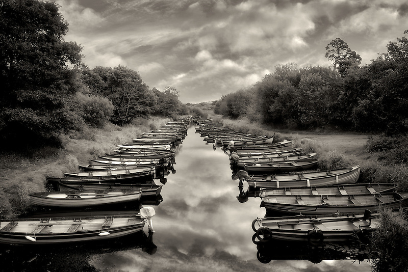 Fishing boats in small inlet. Killarney National Park, Ireland.