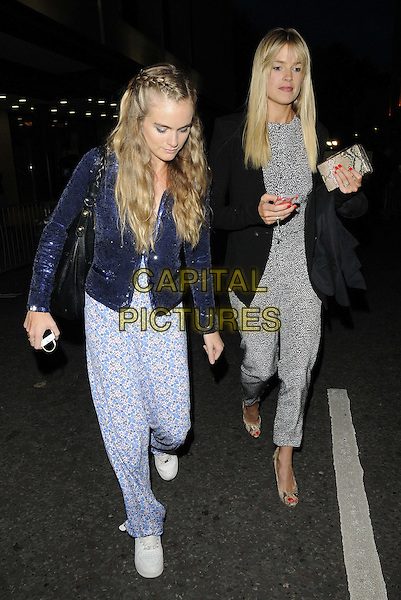 Cressida Bonas &amp; Isabella Calthorpe<br /> attended the WTA Pre-Wimbledon Party, Kensington Roof Gardens, Kensington High St., London, England, UK, 20th June 2013.<br /> full length blue jacket white black print jumpsuit romper catsuit walking trainers  sequined sequin blazer hair braid plait <br /> CAP/CAN<br /> &copy;Can Nguyen/Capital Pictures