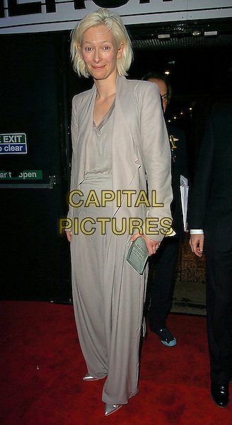 TILDA SWINTON.The British Independent Film Awards at Hammersmith Palais, London, UK..November 30th, 2005.Ref: CAN.full length gray gray trousers jacket award trophy.www.capitalpictures.com.sales@capitalpictures.com.©Capital Pictures