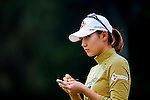 Min-Sun Kim of Korea looks on during the Hyundai China Ladies Open 2014 practice day on December 11 2014 at Mission Hills Shenzhen, in Shenzhen, China. Photo by Xaume Olleros / Power Sport Images
