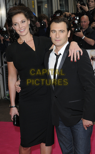 KATHERINE HEIGL & ROBERT LUKETIC .UK Premiere of 'Killers' at the Odeon West End, Leicester Square, London, London, England, UK, June 9th 2010.half length black dress jacket tie jeans white shirt arm around clutch bag wrist watch .CAP/CAN.©Can Nguyen/Capital Pictures.