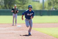Los Angeles Dodgers outfielder James Outman (5) hustles towards third base during an Instructional League game against the Oakland Athletics at Camelback Ranch on September 27, 2018 in Glendale, Arizona. (Zachary Lucy/Four Seam Images)