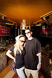 USA, California, San Diego, tattoo artist Zach and girlfriend Kseniva standing inside of Master Tattoo in the Gaslamp district, the oldest tattoo shop on the west coast
