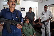 Armed guards pose with Mahendra Karma (centre), the founder of Salwa Judum in Dantewara in Chhattisgarh, India. Photo: Sanjit Das/Panos for The Times
