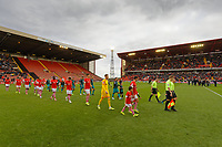 Match officials lead both teams onto the pitch during the Sky Bet Championship match between Barnsley and Swansea City at Oakwell Stadium, Barnsley, England, UK. Saturday 19 October 2019