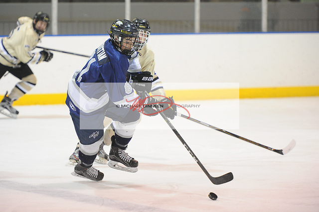 Eagle River's Brook Christian moves the puck up ice vs. South's  Cameron Foraker during the Wolves' 4-2 win at Ben Boeke Arena Thursday, February 2nd, 2017.  Photo for the Star by Michael Dinneen