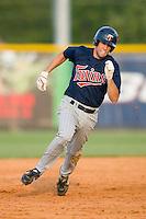 Derek McCallum #7 of the Elizabethton Twins hustles into third base with a triple at Burlington Athletic Park July 19, 2009 in Burlington, North Carolina. (Photo by Brian Westerholt / Four Seam Images)