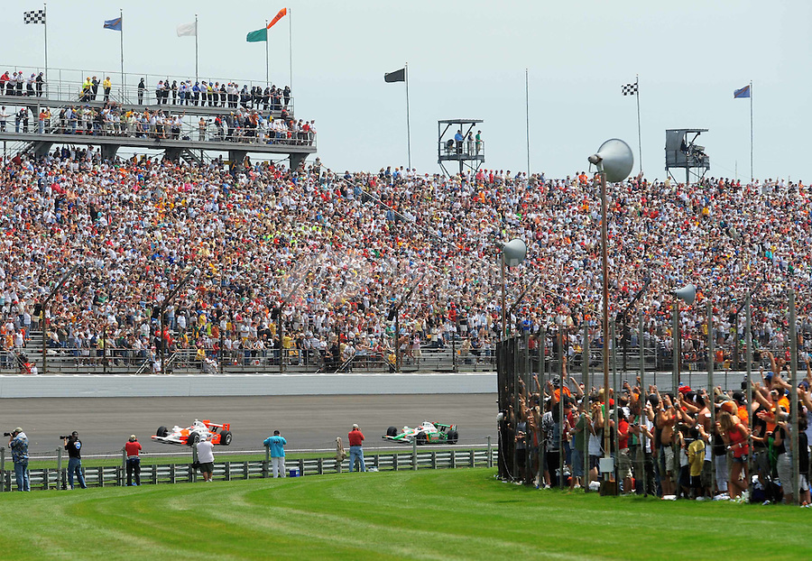 May 25, 2008; Indianapolis, IN, USA; IRL fans watch the race from turn three during the 92nd running of the Indianapolis 500 at the Indianapolis Motor Speedway. Mandatory Credit: Mark J. Rebilas-