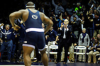 STATE COLLEGE, PA -DECEMBER 19: Head coach Cael Sanderson of the Penn State Nittany Lions celebrates after 285 pounder Jimmy Lawson wins his match in overtime on December 19, 2014 at Recreation Hall on the campus of Penn State University in State College, Pennsylvania. Penn State won 20-15. (Photo by Hunter Martin/Getty Images) *** Local Caption *** Jimmy Lawson;Cael Sanderson
