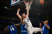 NEW YORK, NY - Thursday March 9, 2017: Luke Fischer (#40) of Marquette is fouled by Ismael Sanogo (#14) of Seton Hall as the two schools square off in the Quarterfinals of the Big East Tournament at Madison Square Garden.