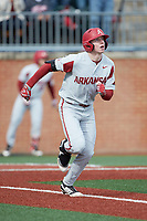 Heston Kjerstad (18) of the Arkansas Razorbacks watches the flight of his 2-run home run as he starts down the first base line during the game against the Charlotte 49ers at Hayes Stadium on March 21, 2018 in Charlotte, North Carolina.  The 49ers defeated the Razorbacks 6-3.  (Brian Westerholt/Four Seam Images)