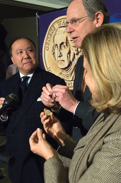 Edmund Moy, director of the U.S. Mint, Rep. Michael Castle, R-Del. and  Joint Economic Committee Vice Chairwoman Carolyn Maloney, D-N.Y. during an media event to preview the new George Washington $1 Coin. .