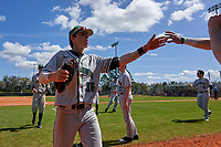 Dartmouth Big Green Trevor Johnson (36) high fives teammates during a game against the Omaha Mavericks on February 23, 2020 at North Charlotte Regional Park in Port Charlotte, Florida.  Dartmouth defeated Omaha 8-1.  (Mike Janes/Four Seam Images)