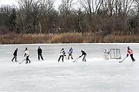 Skating and hockey on Lake Chipican at Canatara Park.