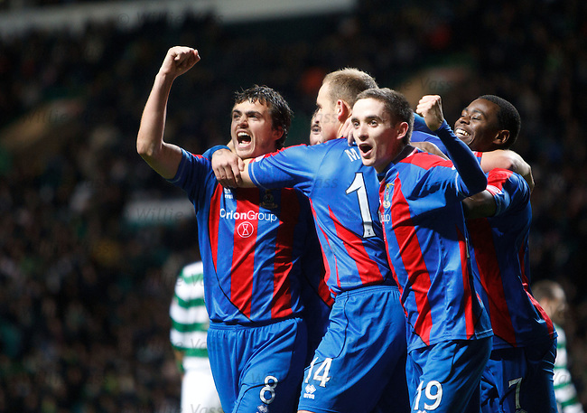 Inverness players mob team-mate Grant Munro as he scores goal no 2 to equalise at Celtic Park