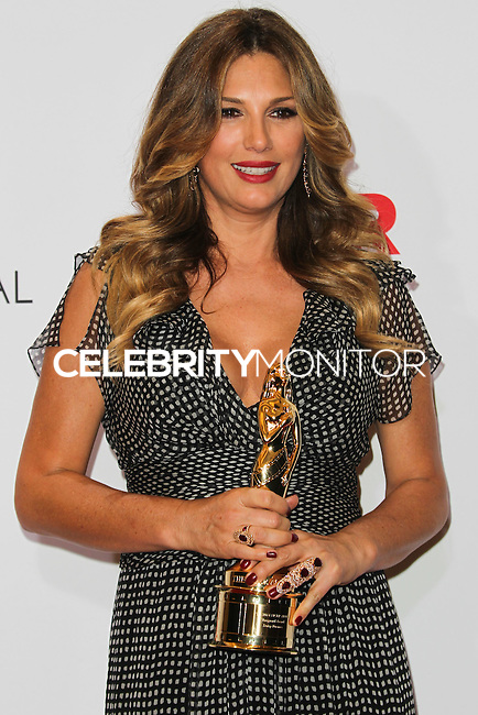 PASADENA, CA, USA - OCTOBER 10: Daisy Fuentes poses in the press room at the 2014 NCLR ALMA Awards held at the Pasadena Civic Auditorium on October 10, 2014 in Pasadena, California, United States. (Photo by Celebrity Monitor)