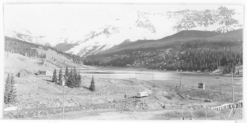 RGS Goose #5 rounding curve at Trout Lake.  Tank is in distance above cabins.<br /> RGS  Trout Lake, CO  Taken by Maxwell, John W. - 5/31/1946