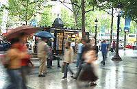 People walking along Champs Élysées in Paris.