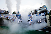 August 30, 2008. Chapel Hill, NC..  In the opening game of the season, the UNC Tarheels beat McNeese State 35- 27 in a game delayed by foul weather.. The team enters the field.