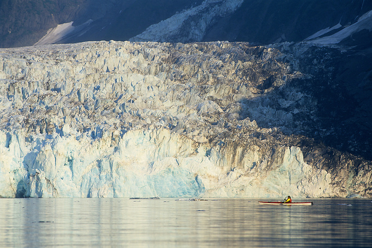 A sea kayaker paddles past Surprise Glacier in Harriman Fjord, north of Whittier, Alaska, in Prince William Sound.