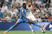 Real Madrid's Karim Benzema (r) and Getafe CF's Djene Dakoman during La Liga match. August 19,2018.  *** Local Caption *** &copy; pixathlon<br /> Contact: +49-40-22 63 02 60 , info@pixathlon.de