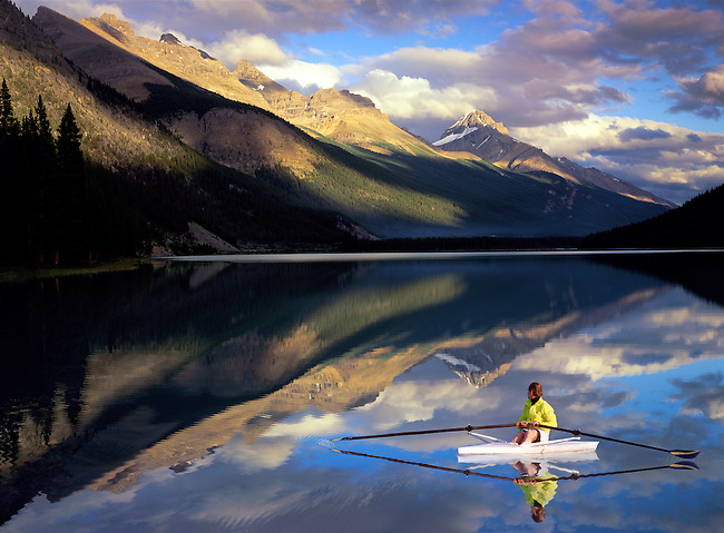 A rower on Banff Lake in awe of a spectacular view and water as smooth as glass. (MR)