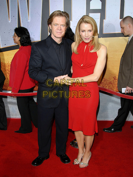 "WILLIAM H. MACY & FELICITY HUFFMAN.attends The Touchstone Pictures' World Premiere of ""Wild Hogs"" held at The El Capitan Theatre in Hollywood, California, USA, February 27 2007. .full length red dress couple married holding hands.CAP/DVS.©Debbie VanStory/Capital Pictures"