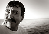 MEXICO, Baja, Magdalena Bay, Pacific Ocean, Enrique the guide during a grey whale watching tour in the bay