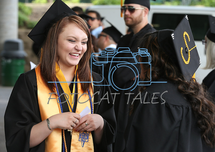 Taylor Keema, left, and Sharleen Manriquez talk before the Western Nevada College commencement at the Pony Express Pavilion, in Carson City, Nev., on Monday, May 19, 2014. A record-high 543 students graduate from WNC this week. <br /> Photo by Cathleen Allison/Nevada Photo Source