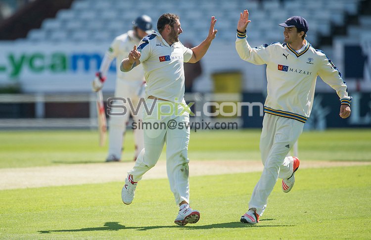 Picture by Allan McKenzie/SWpix.com - 26/04/2015 - Cricket - LV County Championship Div One - Yorkshire County Cricket Club v Warwickshire County Cricket Club - Headingley Cricket Ground, Leeds, England - Yorkshire's Tim Bresnan is congratulated by jack Brooks on dismissing William Porterfield of Warwickshire.