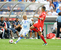 El Salvador Denis Alas (14) makes a pass against Panama Ramon Sanchez (7)  Team Photo.  Panama defeated El Salvador in penalty kicks 5-3 in the quaterfinals for the 2011 CONCACAF Gold Cup , at RFK Stadium, Sunday June 19, 2011.