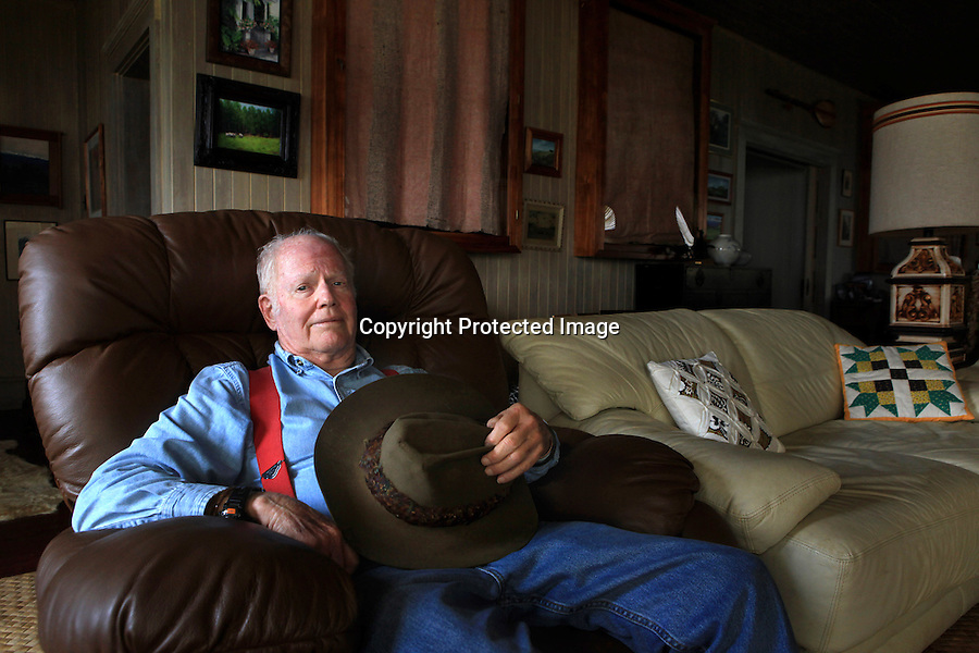 """Monty Richards, owner of Kahua Ranch is photographed in his living room in North Kohala, Hawaii.  """"Ranches are struggling,"""" says Richardson, who sold a large piece of his ranch to real estate developers a number of years ago and also added ATV and horseback riding adventures to his ranch's offerings. High land taxes, rising costs of shipping cattle to the mainland and changing weather patterns have all adversely affected the viability of ranching in Hawaii."""