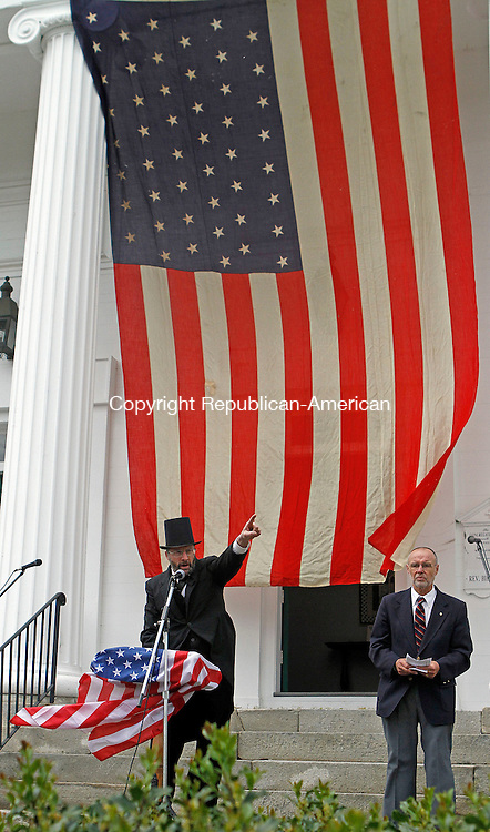 Terryville, CT-052613MK08 Abraham Lincoln, portrayed by Jerry Milne, points to historical landmarks surrounding the crowd during Memorial Day Exercises on Saturday morning on Plymouth Green. Michael Kabelka / Republican-American