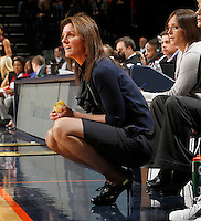 Virginia Cavaliers head coach Joanne Boyle kneels court side during the game against Florida State Jan. 29, 2012 in Charlottesville, Va.  Virginia defeated Florida State 62-52.