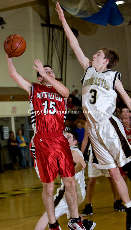 THOMASTON, CT - 30 DECEMBER 2008 -123008JT08-<br /> Thomaston's Nick Russo tries to block a shot by Northwestern's Russell Dougan during Tuesday's game at Thomaston. Northwestern won, 51-44.<br /> Josalee Thrift / Republican-American