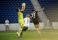 Red Stars goalkeeper Jillan Loyden (1) makes the save over teammate Katie Chapman (17) and FC Gold Pride midfielder Shannon Boxx (77).  The FC Gold Pride defeated the Chicago Red Stars 3-2 at Toyota Park in Bridgeview, IL on August 22, 2010