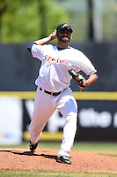Huntsville Stars pitcher Arcenio Leon (34) delivers a pitch during a game against the Mobile BayBears on April 23, 2014 at Joe Davis Stadium in Huntsville, Tennessee.  Huntsville defeated Mobile 4-1.  (Mike Janes/Four Seam Images)