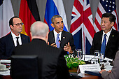 United States President Barack Obama, center, speaks as Xi Jinping, China's president, right, and Francois Hollande, France's president, left, listen during a P5+1 multilateral meeting at the Nuclear Security Summit in Washington, D.C., U.S., on Friday, April 1. After a spate of terrorist attacks from Europe to Africa, Obama is rallying international support during the summit for an effort to keep Islamic State and similar groups from obtaining nuclear material and other weapons of mass destruction. <br /> Credit: Andrew Harrer / Pool via CNP