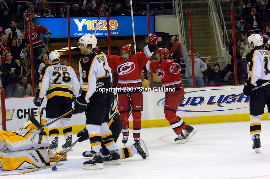 Carolina Hurricanes' Erik Cole, center, celebrates his second goal of the game with teammate Eric Staal, center right, as the Boston Bruins' Brad Boyes (26) and Brad Stuart (6) look on Saturday, Feb. 3, 2007 at the RBC Center in Raleigh. Boston won 4-3 in overtime.