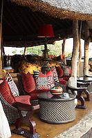 A seating area on a covered terrace at Singita Pamushana Lodge, Malilongwe Trust, Zimbabwe