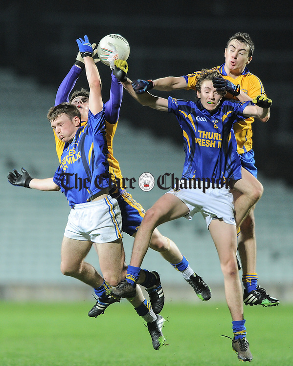 Keelan Sexton and Niall Mc Carthy of Clare in action against Emmett Moloney and Jack Kennedy of Tipperary during their U-17 Munster League final in The Gaelic Grounds. Photograph by John Kelly.