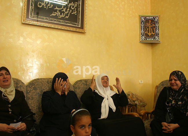 The mother and relatives of Rabia Tawil mourn at his house in the village of Tsur Baher, in East Jerusalem on Sep 22, 2009. Troops shot dead Tawil, a Palestinian motorist, in Israel on Tuesday, saying he failed to stop at a border checkpoint coming from the West Bank and later drove at soldiers seeking to detain him at a fuel station. Photo by Mahfuz Abu Turk