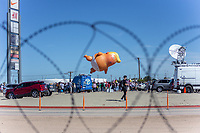 "MEXICALI, MEXICO - April 5 ""Baby Trump"" Balloon is seen floating thru barbed wire at a protest against the President of the United States on April 5, 2019 in Mexicali, Mexico.<br /> President Trump on Friday visited Calexico, a small city in a largely agricultural region between Arizona and the Pacific, to inspect an upgraded portion of fencing and to meet with law enforcement. That's more attention than usual for a border town that locals say is defined by its interconnection with Mexico, its infernal summers and its labor-based economy. <br /> (Photo by Luis Boza/VIEWpress)"