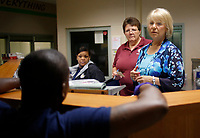 NWA Democrat-Gazette/DAVID GOTTSCHALK  Jeanne Mack (from right), director of the Washington County Juvenile Detention Center, speaks Monday, July 2, 2018, with Judy Marion, executive assistant, Rita Bell, youth care worker, and Kendrick Sexton, assistant director, at the staff station inside the center in Fayetteville.