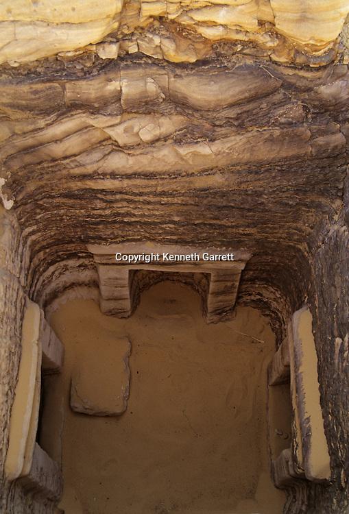 Tomb 55 shaft has four Greek stlye entrances to burial chambers,.Egypt; Archaeology; Bahariya Oasis; Greco-Roman;Golden Mummies; Valley of the Golden Mummies; Book originals; mummies