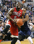 UNLV's Ike Nwamu battles Nevada's D.J. Fenner during a men's college basketball game against in Reno, Nev., on Saturday, Jan. 23, 2016. Cathleen Allison/Las Vegas Review-Journal