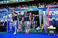 Lincoln City's Michael Bostwick, left, and Lincoln City's Neal Eardley lead their team-mates out at the start of the pre-match warm-up<br /> <br /> Photographer Chris Vaughan/CameraSport<br /> <br /> The Carabao Cup First Round - Huddersfield Town v Lincoln City - Tuesday 13th August 2019 - John Smith's Stadium - Huddersfield<br />  <br /> World Copyright © 2019 CameraSport. All rights reserved. 43 Linden Ave. Countesthorpe. Leicester. England. LE8 5PG - Tel: +44 (0) 116 277 4147 - admin@camerasport.com - www.camerasport.com