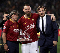 Football, Serie A: AS Roma - Parma, Olympic stadium, Rome, May 26, 2019. <br /> Roma's Daniele De Rossi (c) is congratulated by former captain Francesco Totti (r) and Roma's Bruno Conti (l) during his farewell to Roma after 18 years at his home-town club at the end of the Italian Serie A football match between Roma and Parma at Olympic stadium in Rome, on May 26, 2019.<br /> UPDATE IMAGES PRESS/Isabella Bonotto
